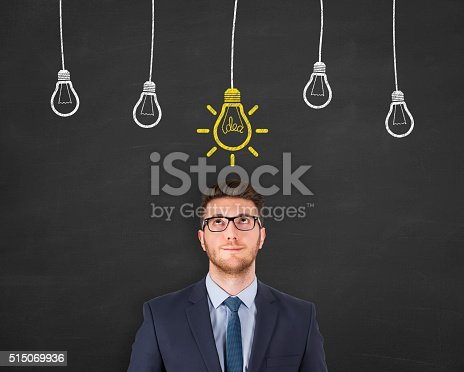 645716366 istock photo Idea Light Bulb on Blackboard 515069936