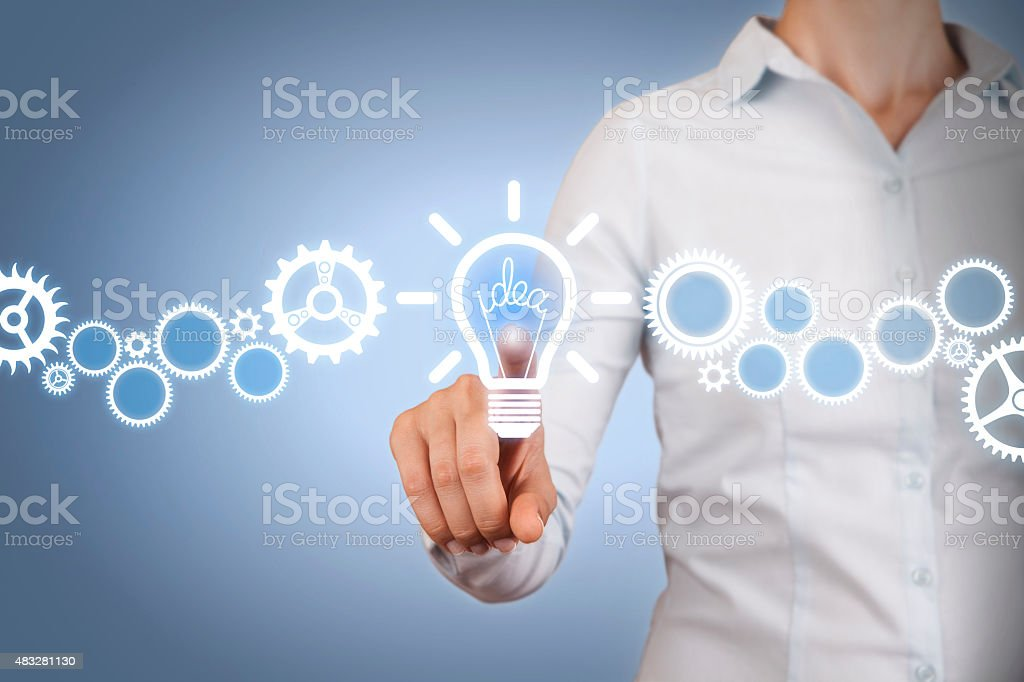 Idea Light Bulb Touching on Visual Screen stock photo