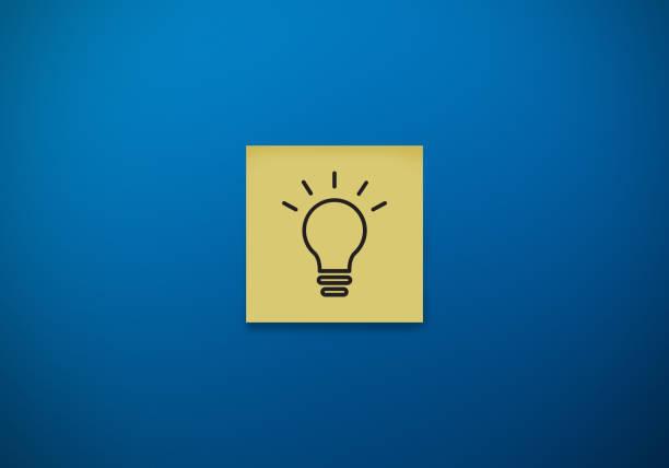 Idea, lightbulb drawn on sticky note even surface stock photo