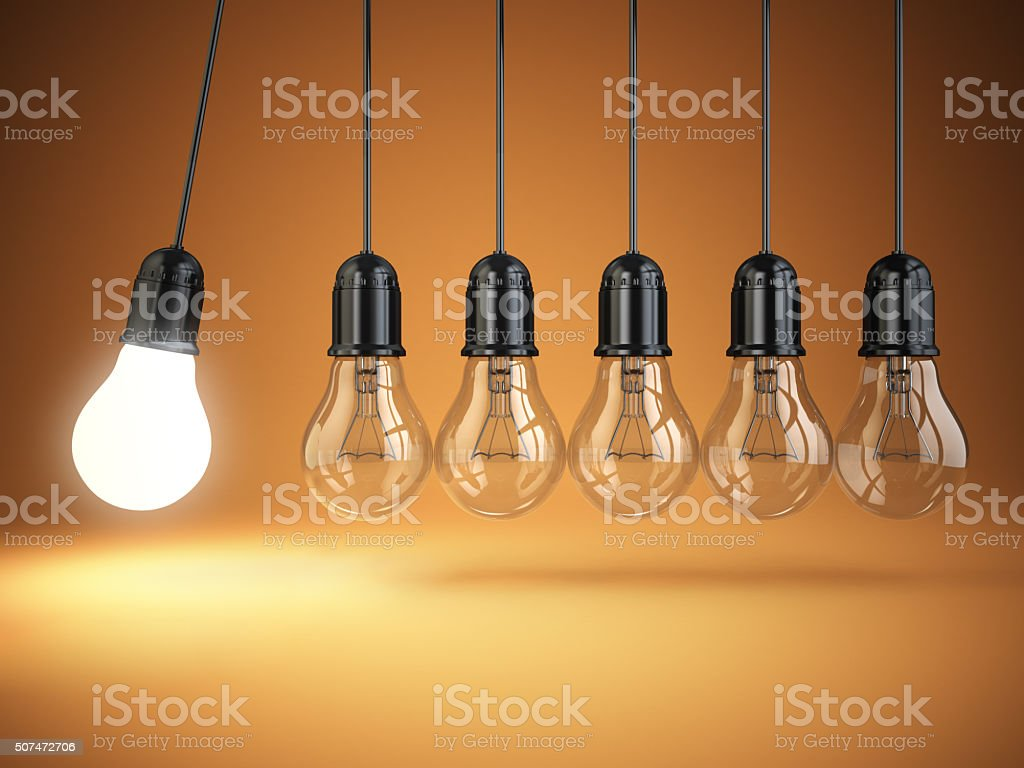 Idea o creativity concept. Light bulbs and perpetual motion. stock photo