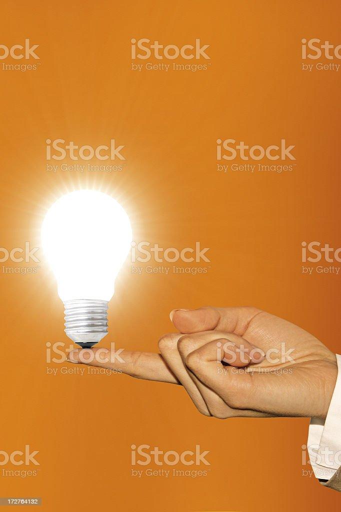 light bulb on hand as a symbol of an idea
