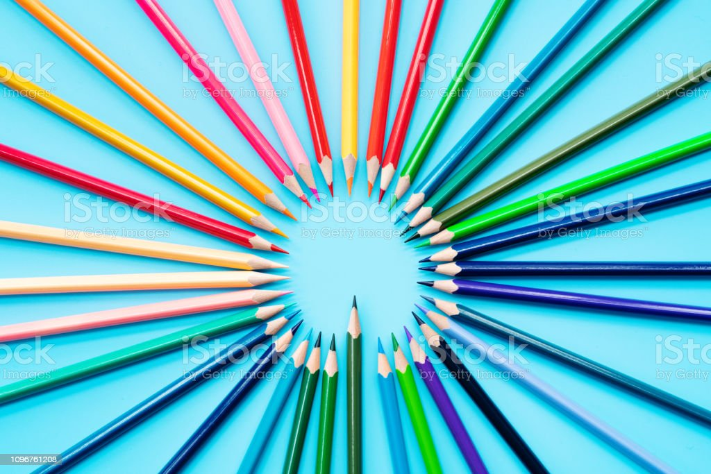 Idea sharing concept, multicolored pencils on blue background stock photo