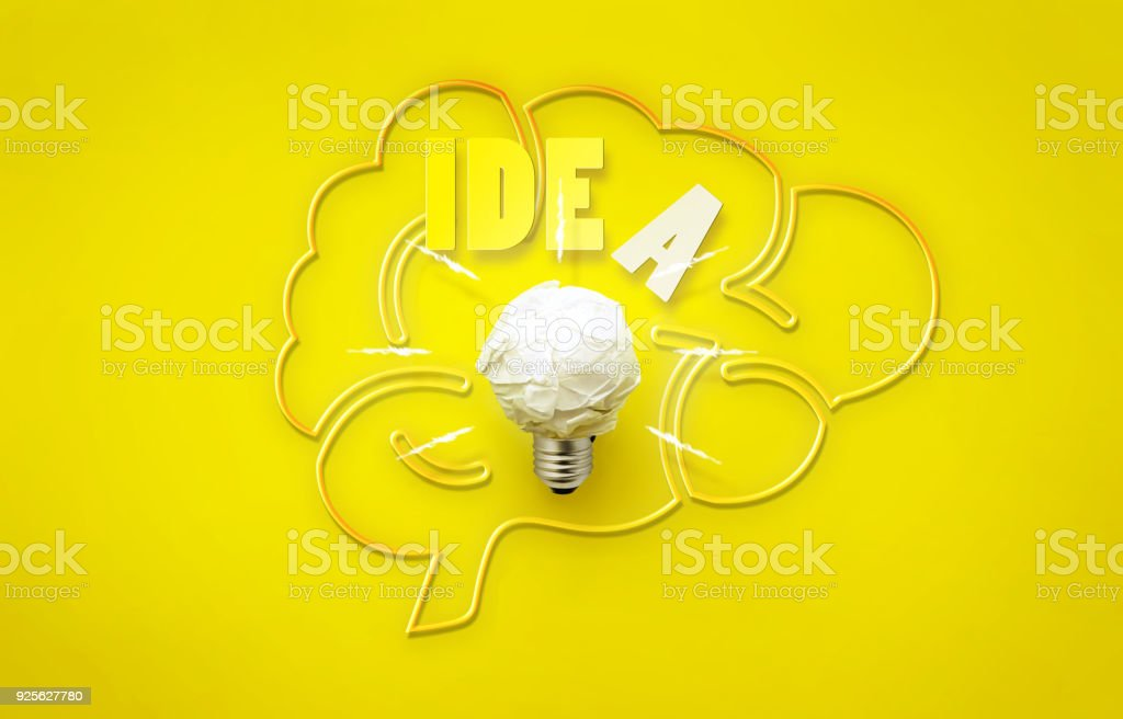 idea with new innovations with paper and brain bulbs on a yellow background. stock photo
