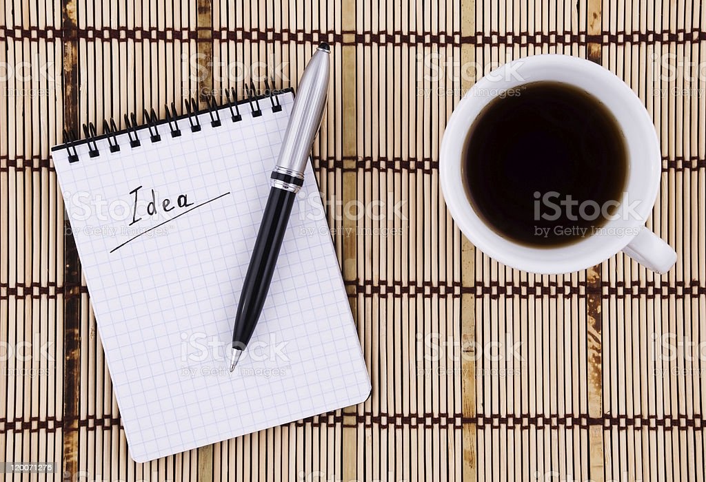 Idea written in notepad, Pen and Coffee Cup. royalty-free stock photo