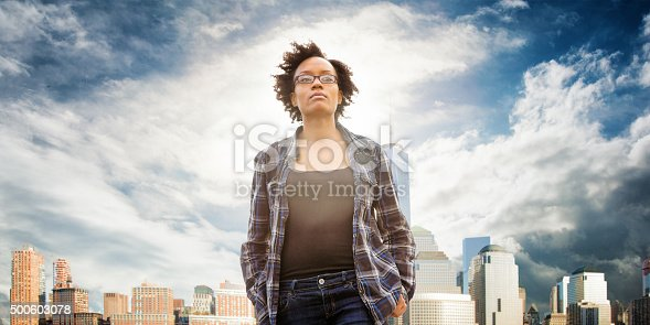 istock Idealistic young woman daydreaming in front of New York City 500603078
