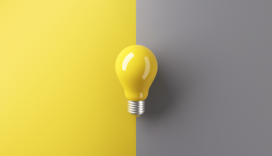 Ideas concepts, Creativity inspiration, White Lightbulb on grey and yellow background, copy space, 3d render.