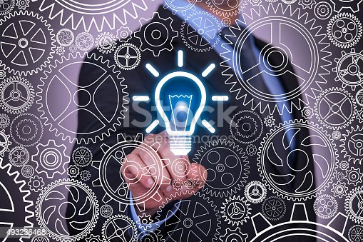 872670540 istock photo Ideas Concepts Light Bulb and Gears on Vitual Screen 493236468