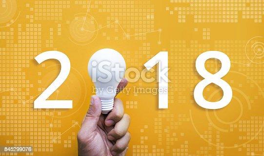 845301446 istock photo 2018 Ideas creativity concept with human hand holding light bulb 845299076