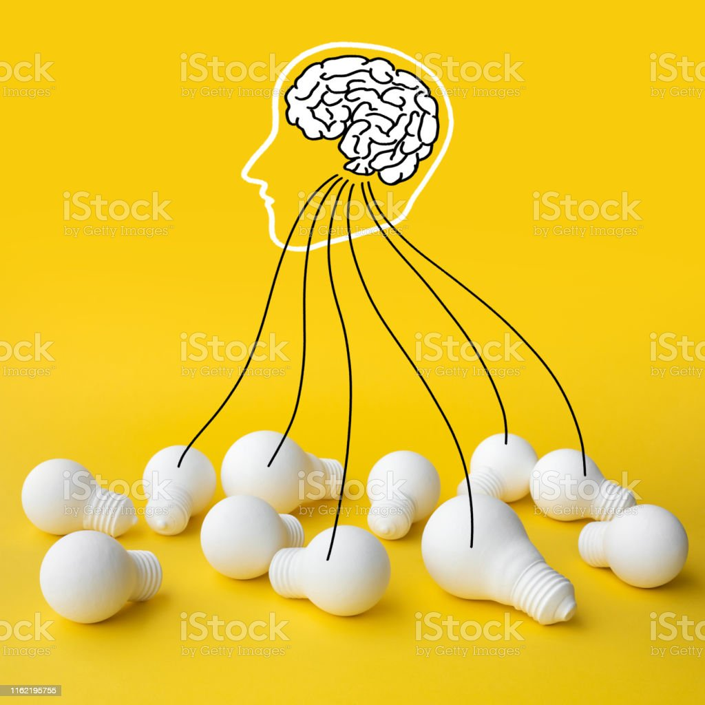 Ideas inspiration concepts with brain in head and group of lightbulb...