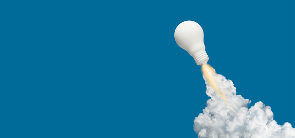 istock Ideas inspiration concepts with rocket lightbulb on blue background.Business start up or goal to success 1159122543