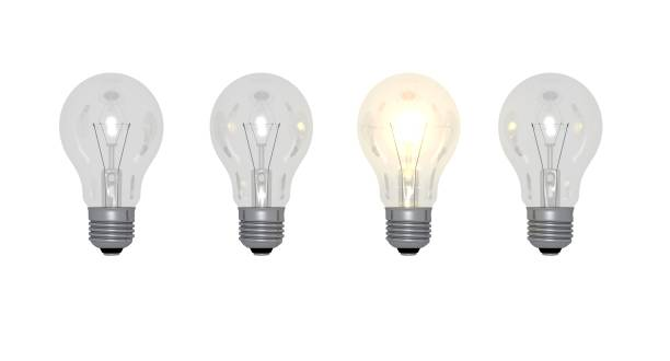 ideas sign symbol icon glowing light bulb isolated on white background stock photo