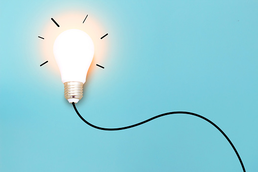 istock Ideas with  light bulb on blue background .Creative business concept. 1085928084