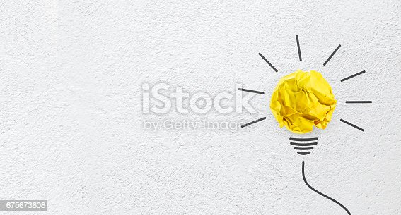 istock Ideas with yellow paper crumpled ball on wall( lightbulb ). 675673608