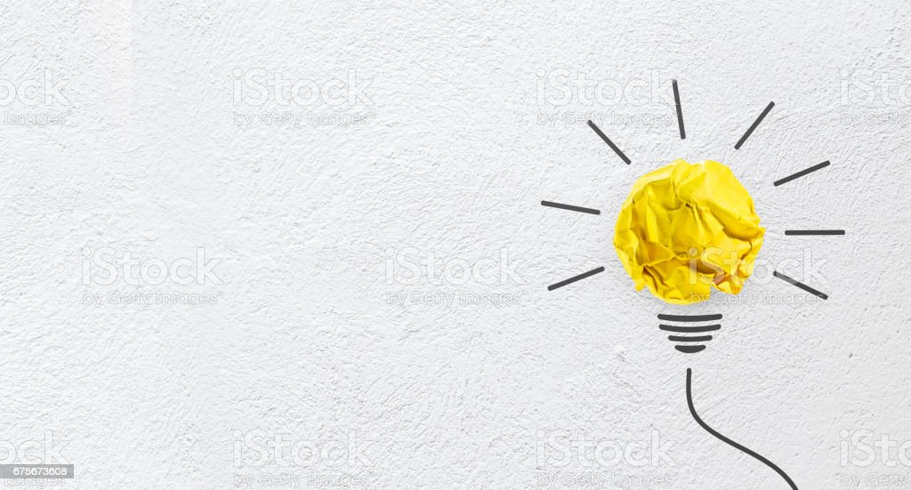 Ideas with yellow paper crumpled ball on wall( lightbulb ). stock photo
