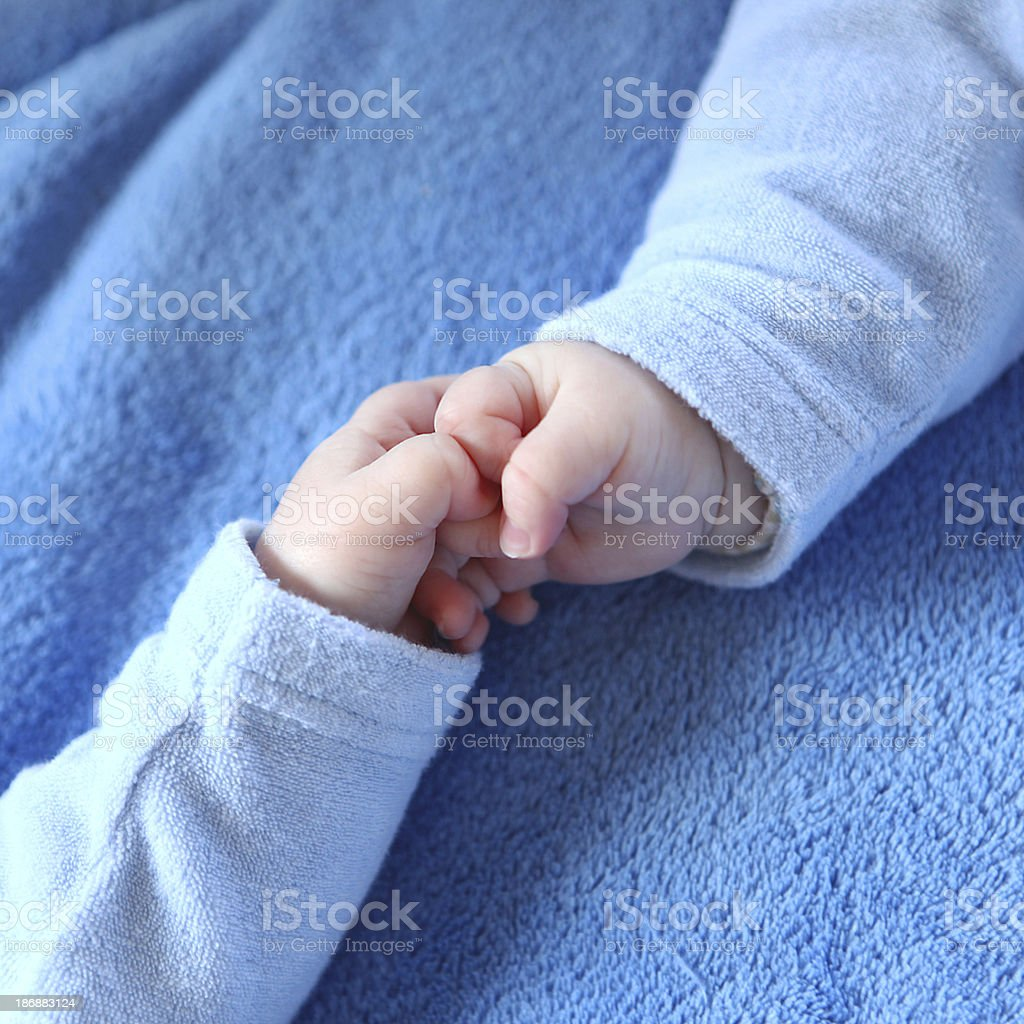 Identical Twin Baby Boys Holding Hands stock photo