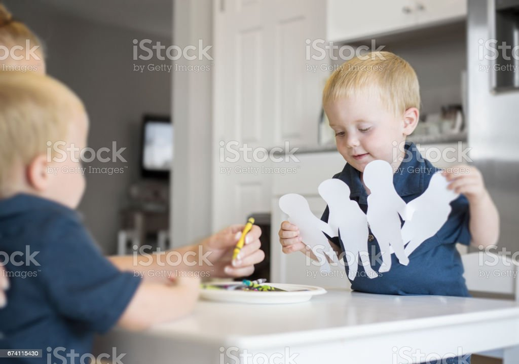 Identical Twins learning art and craft 免版稅 stock photo