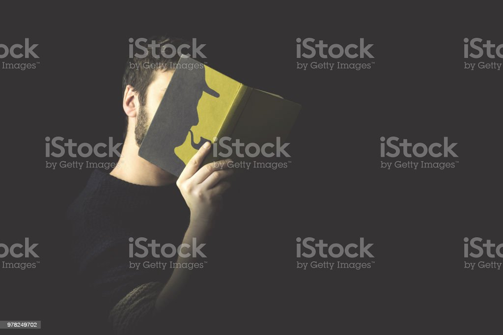 identify oneself in a thriller book stock photo