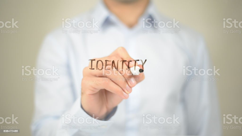 Identity , Man writing on transparent screen stock photo