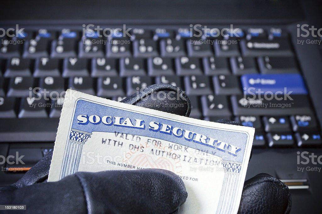 Identity theft on laptop computer stock photo