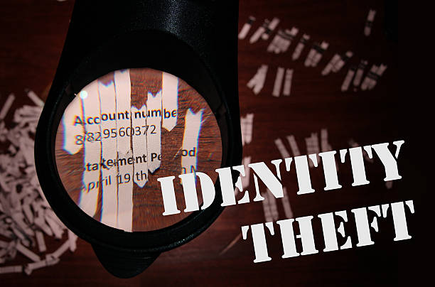 Identity thief piecing together a bank statement - Photo