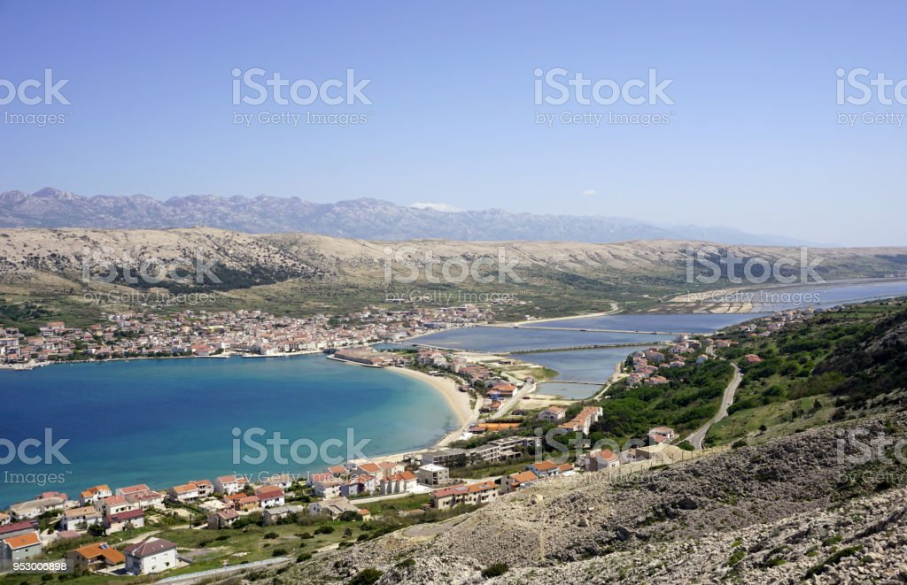 Idyllic aerial view on blue and turquoise bay and old town Pag on the Island of Pag in Dalmatia, Croatia stock photo