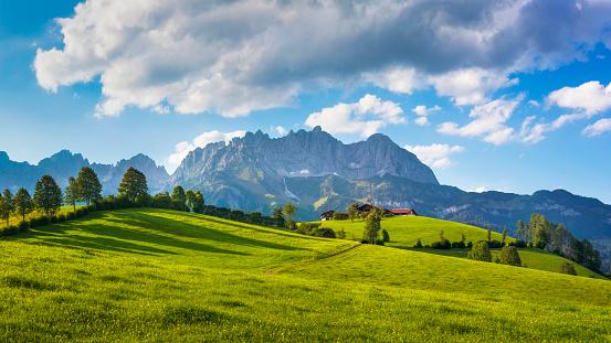 Idyllic alpine scenery, farmhouse in front of Wilder Kaiser, Austria, Tirol  - Kaiser Mountains