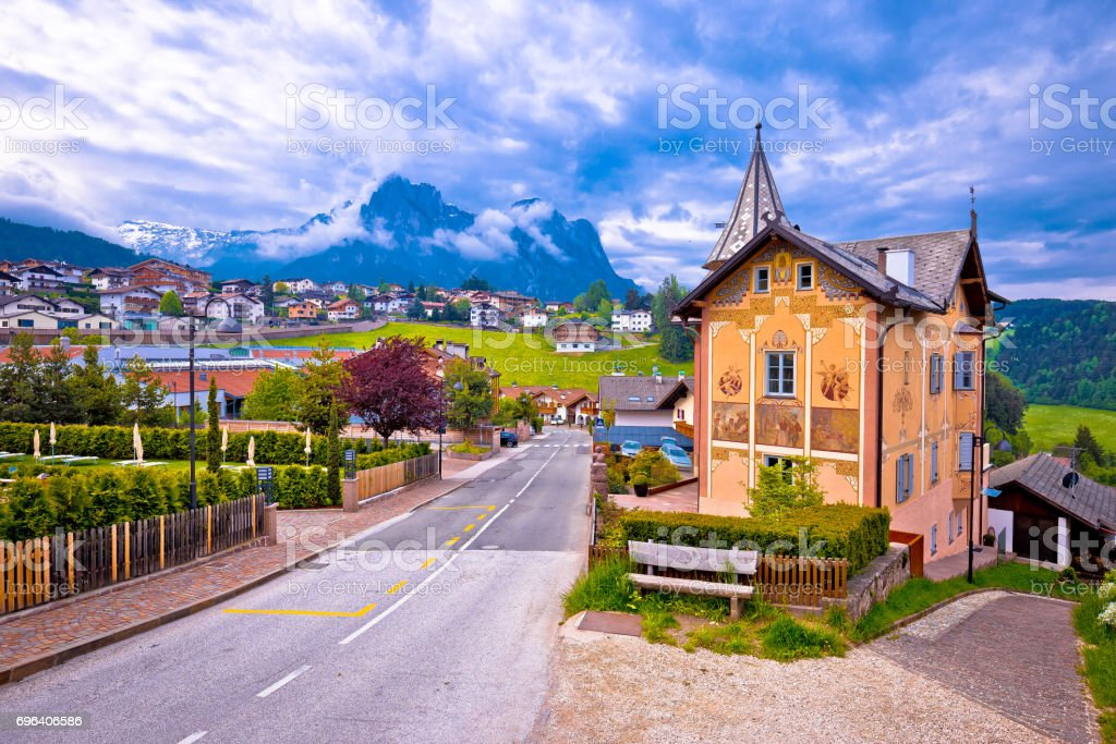 Idyllic Alpine town of Kastelruth architecture and mountains view, Trentino Alto Adige region of Italy stock photo