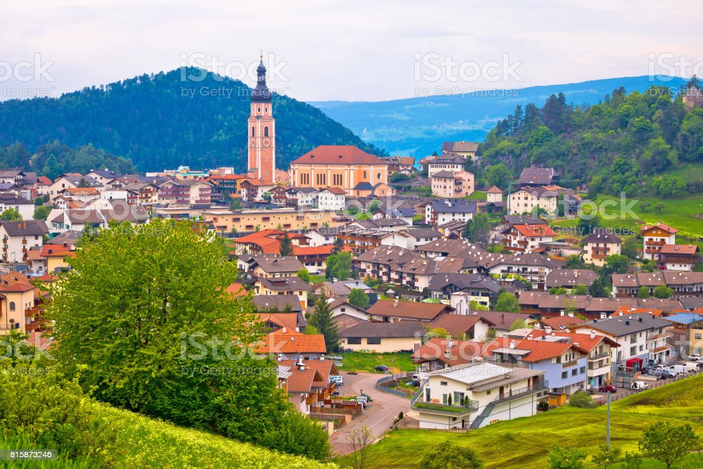 Idyllic Alpine town of Kastelruth on green hill view, Trentino Alto Adige region of Italy stock photo