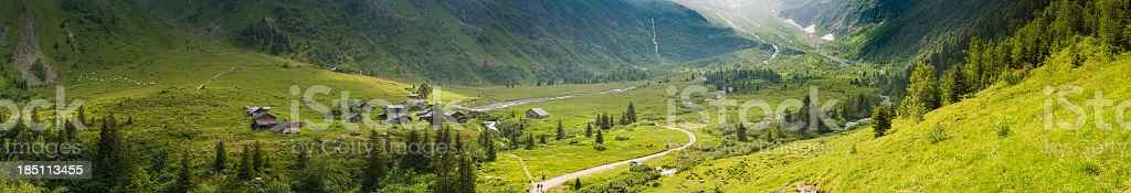 Idyllic Alpine village valley panorama summer mountain meadows Alps royalty-free stock photo