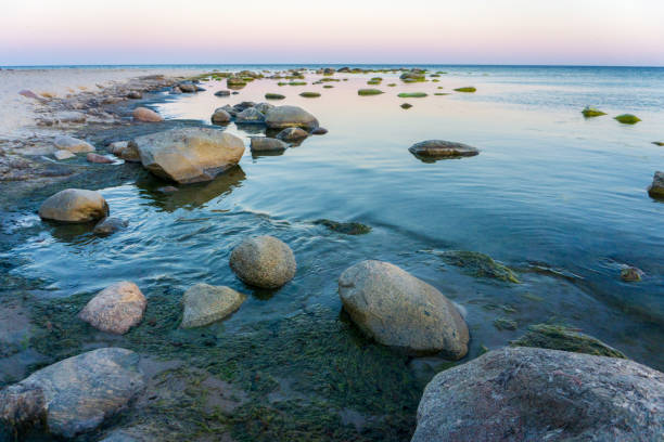 Idyllic Baltic sea with rocks in Bornholm, Denmark on a day in summer stock photo