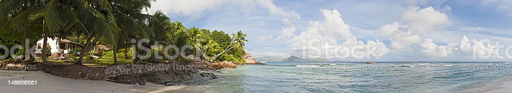 Idyllic beach house tropical island paradise panorama turquoise ocean Seychelles royalty-free stock photo