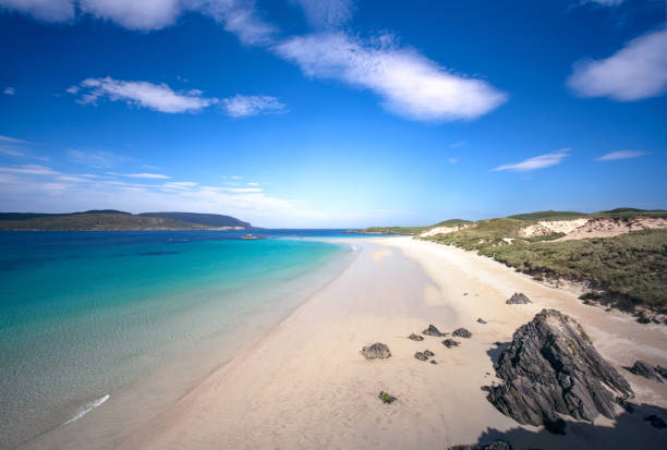 Idyllic beach on Scotland's north coast Perfect conditions at Balnakeil Beach in Durness, on Scotland's far north coast. north coast 500 stock pictures, royalty-free photos & images