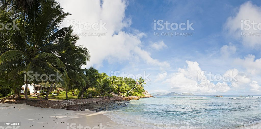 Idyllic beach retreat palm fringed island lagoon royalty-free stock photo