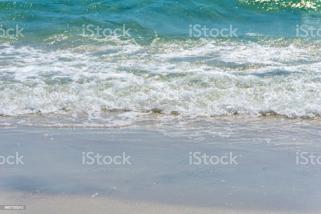 Idyllic beach with clear water and waves in Bornholm, Denmark on a day in summer - Royalty-free Awe Stock Photo