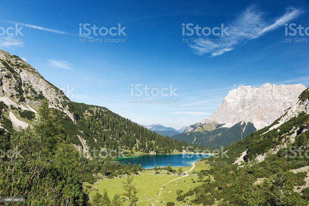 idyllic blue mountain lake in austrian alps with blue sky stock photo