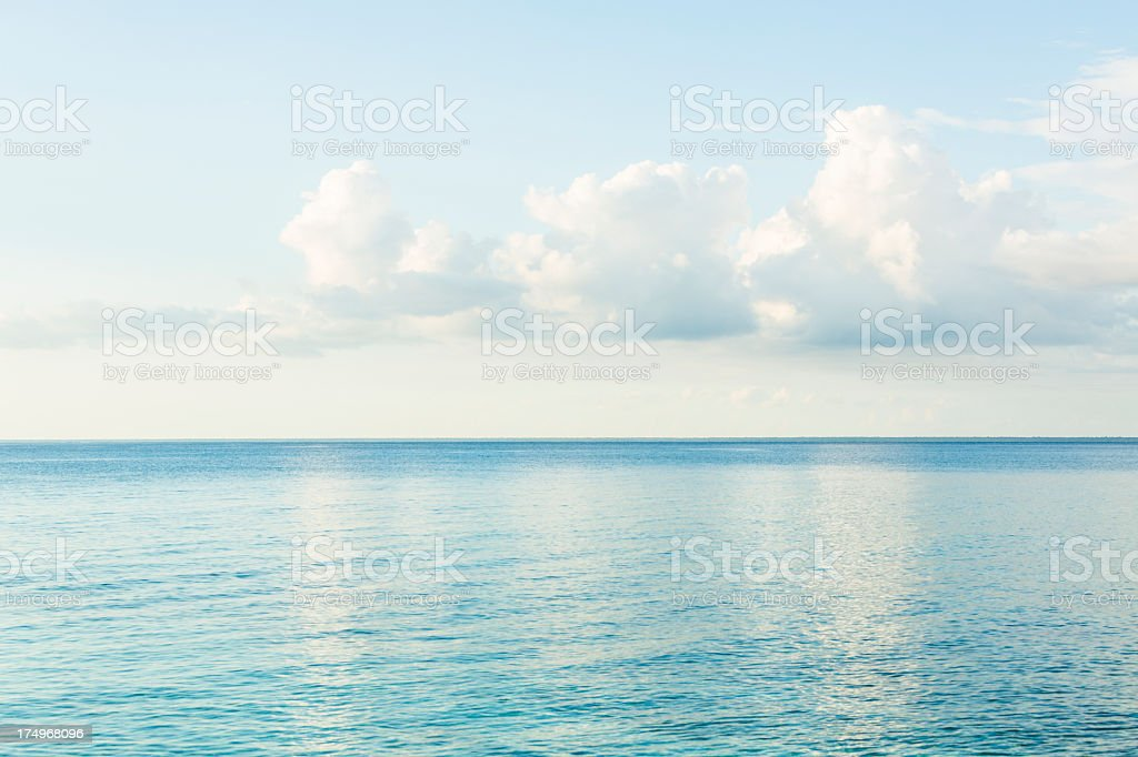 Idyllic bright seascape with clouds reflecting in water. royalty-free stock photo