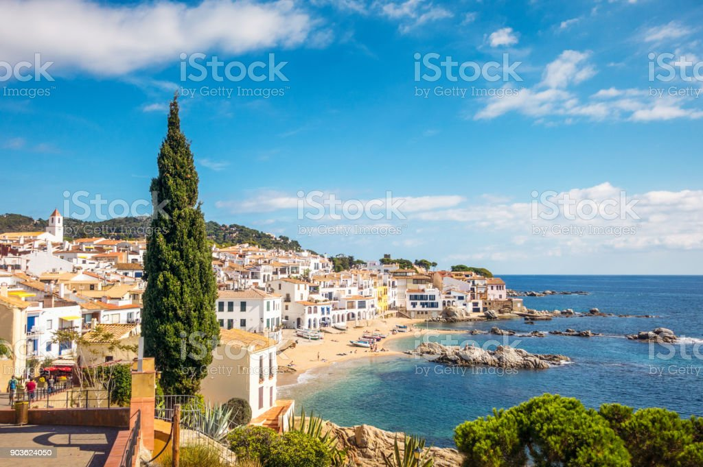 Idyllic Costa Brava seaside town in Girona Province, Catalonia The pretty seaside town and natural bay of Calella de Palafrugell on Catalonia's Costa Brava. Architecture Stock Photo