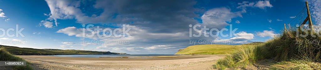 Idyllic deserted beach dunes sky stock photo