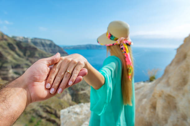 idyllic engagement on vacations - diamond ring hand stock photos and pictures