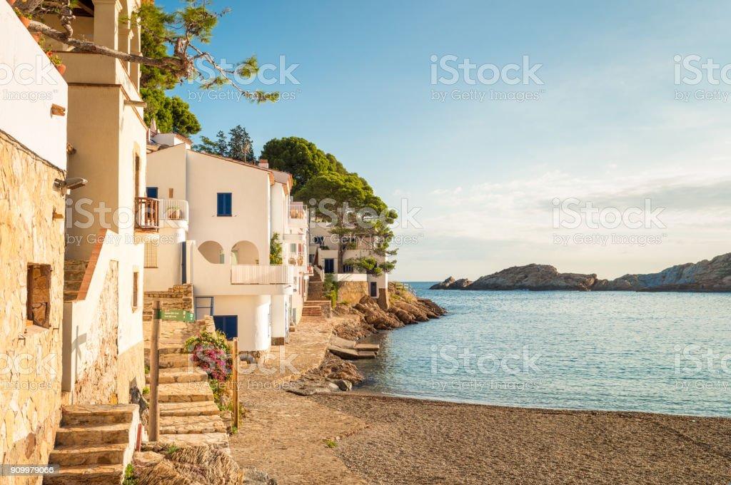 Idyllic fishing village of Sa Tuna - Costa Brava Houses surrounding the idyllic bay at Sa Tuna, on the Catalan Costa Brava coast, Spain. Architecture Stock Photo