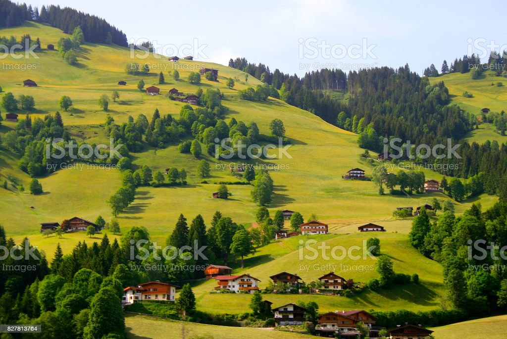 Idyllic Gstaad and Saanen alpine valley and meadows, dramatic fairy tale swiss Chalets, idyllic countryside, Bern canton,Swiss Alps, Switzerland stock photo