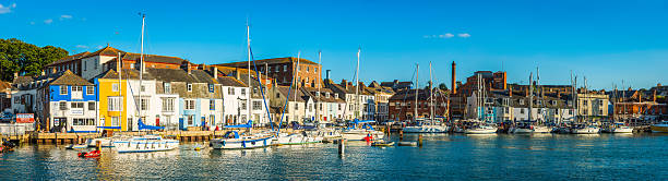 idyllic harbour marina panorama fishing cottages tourists pubs weymouth dorset - weymouth stock photos and pictures