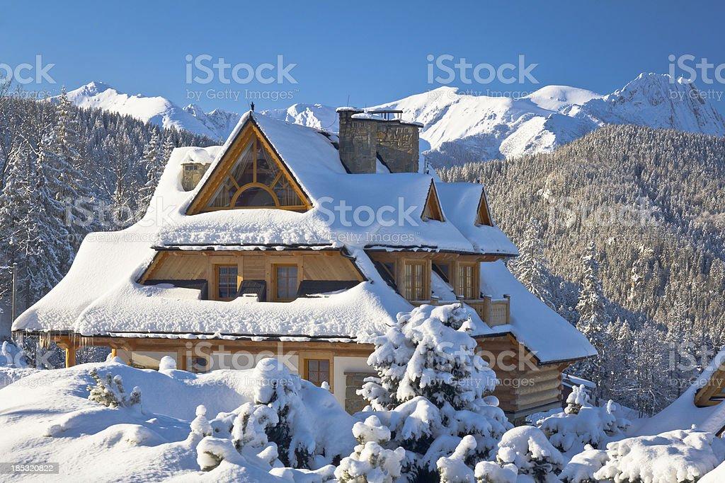 Idyllic Holiday Mountain Chalet in snow stock photo