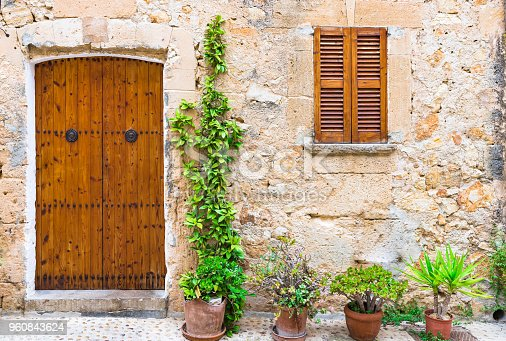 istock Idyllic home, mediterranean house with potted plants in front of entrance 960843624