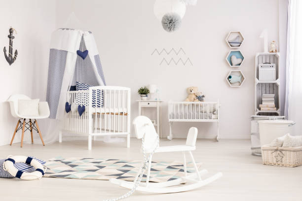 idyllic infant room ready to welcome its first occupant - nautisches schlafzimmer stock-fotos und bilder