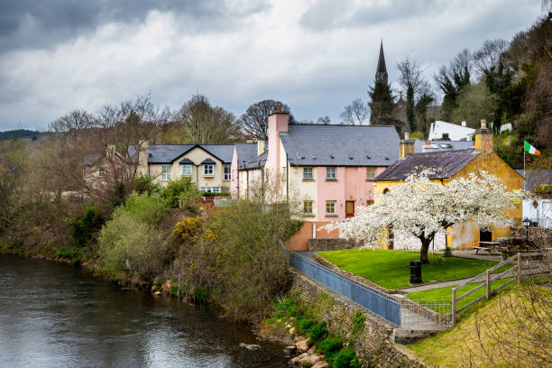 Idyllic Irish village with colorful houses by a river. stock photo