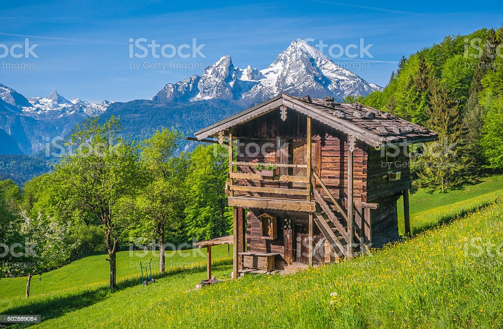 Idyllic landscape in the Alps with traditional mountain lodge stock photo