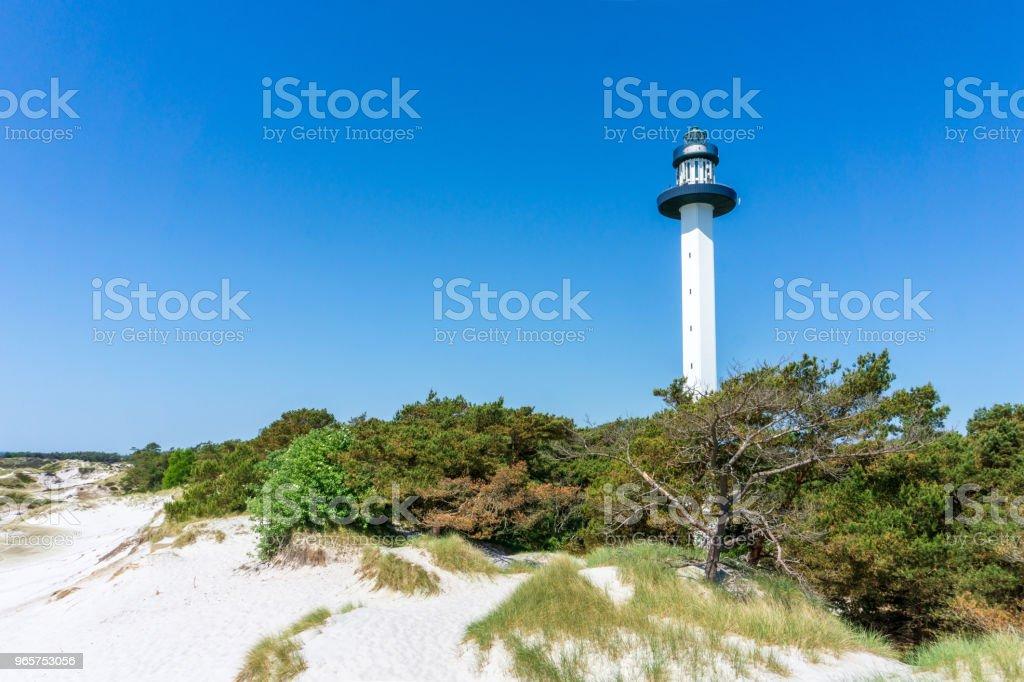Idyllische vuurtoren met zandduinen in Bornholm, Denmark op een dag in de zomer - Royalty-free Achtergrond - Thema Stockfoto