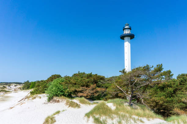 Idyllic lighthouse with sand dunes in Bornholm, Denmark on a day in summer stock photo