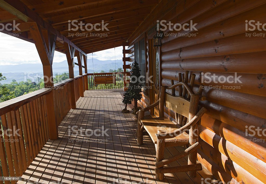 Idyllic Log Cabin Front Porch royalty-free stock photo